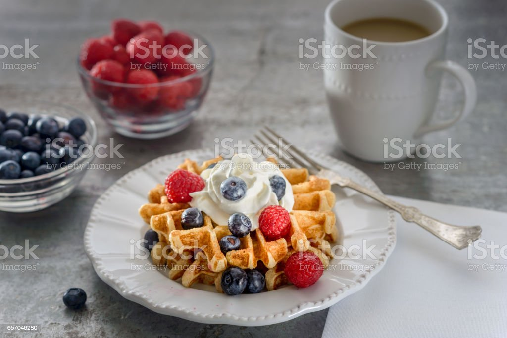 Blueberry and raspberry waffle place setting stock photo