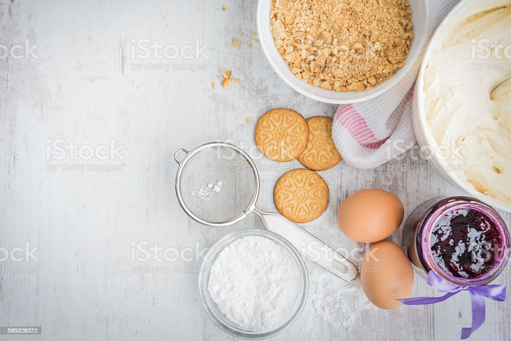 Blueberry cheese cake ingredients prepared over a white wood background. stock photo