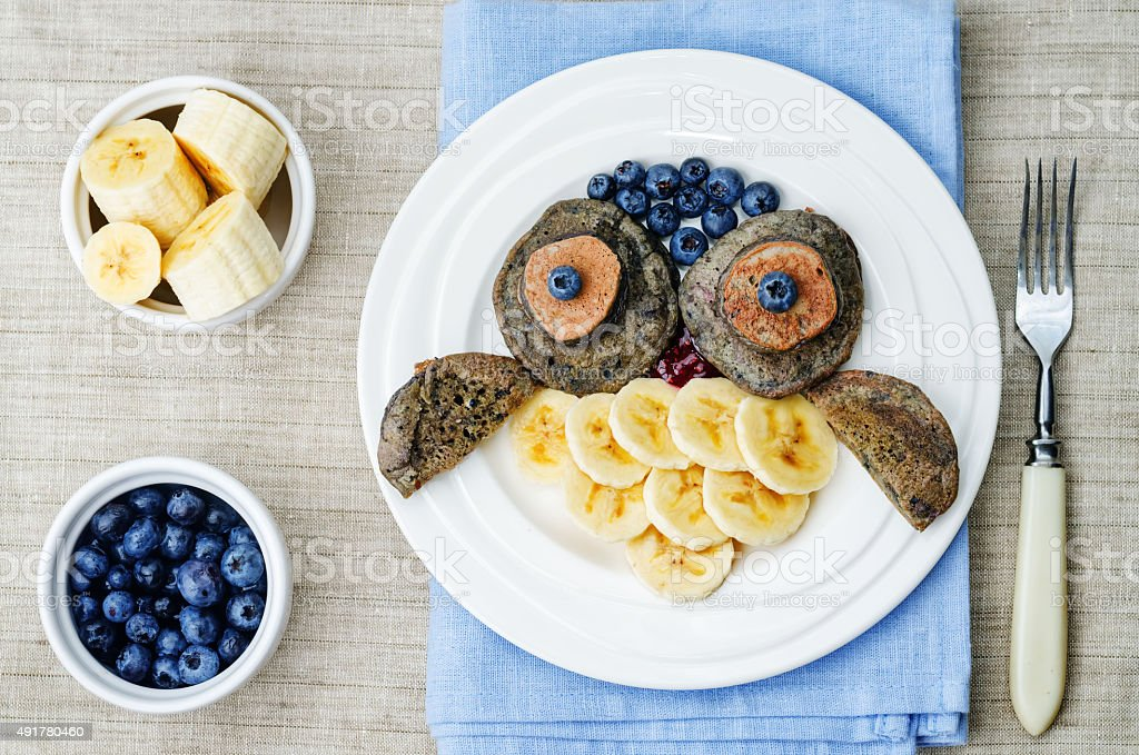 blueberry chocolate pancake with bananas for kids stock photo