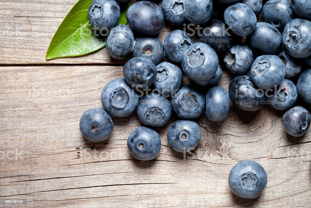 Blueberry close up on wooden table stock photo