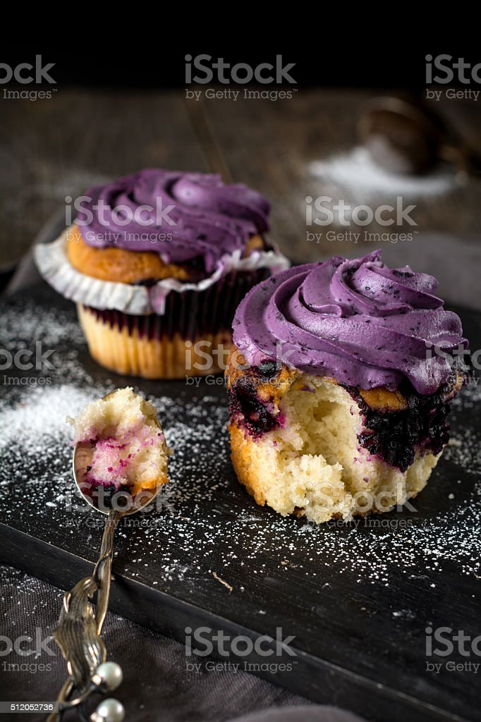 Blueberry cupcakes with blueberry buttercream stock photo