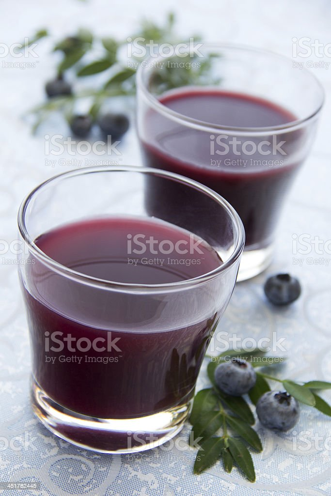 Blueberry juice in a glass. stock photo