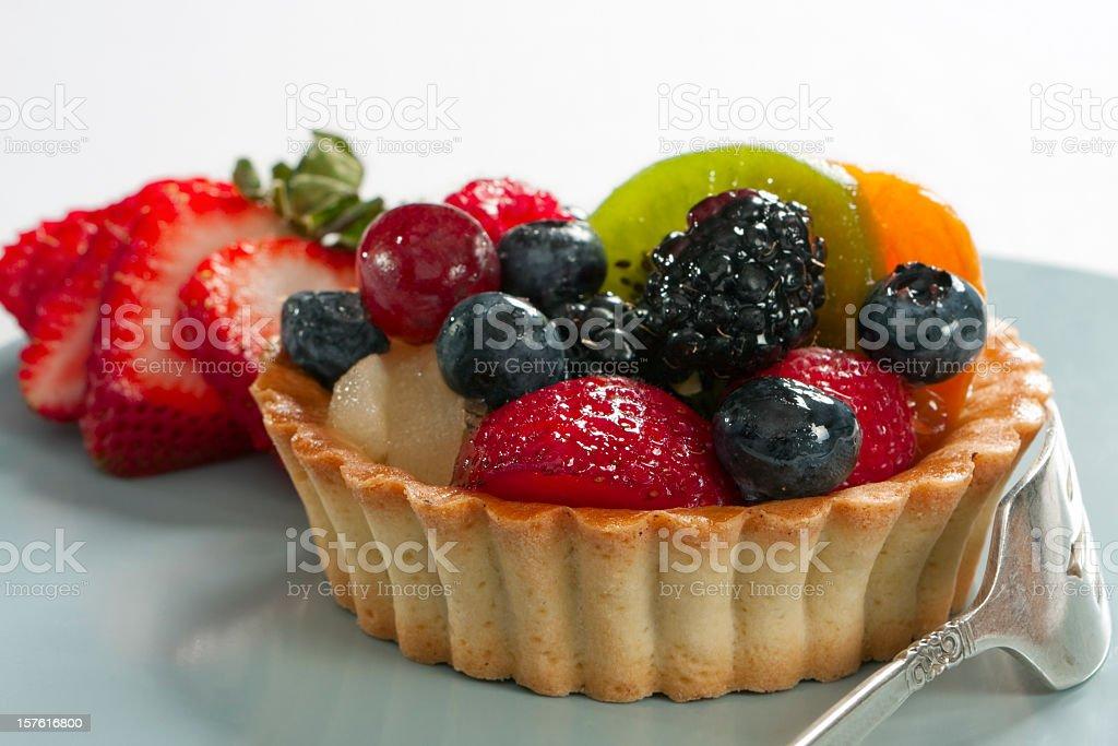 Blueberry kiwi strawberry individual tart royalty-free stock photo