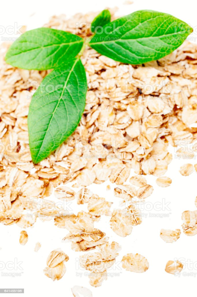 Blueberry leaves with rolled oats, on white stock photo