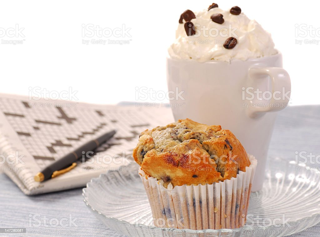 Blueberry muffin and a latte coffee royalty-free stock photo