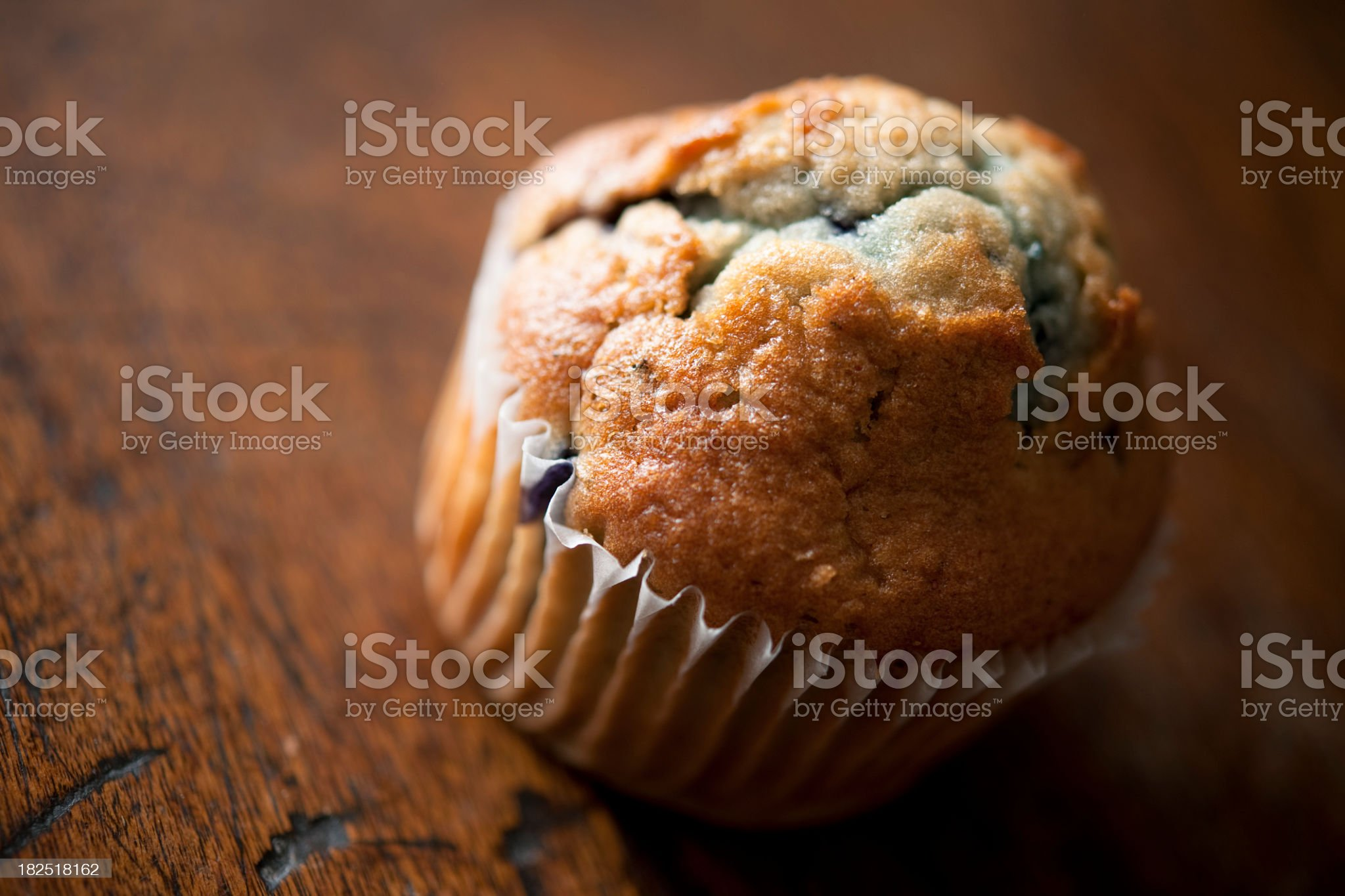 Blueberry Muffin on a rustic wooden background royalty-free stock photo