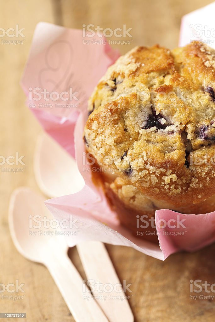 blueberry muffin on wooden table with spoons royalty-free stock photo