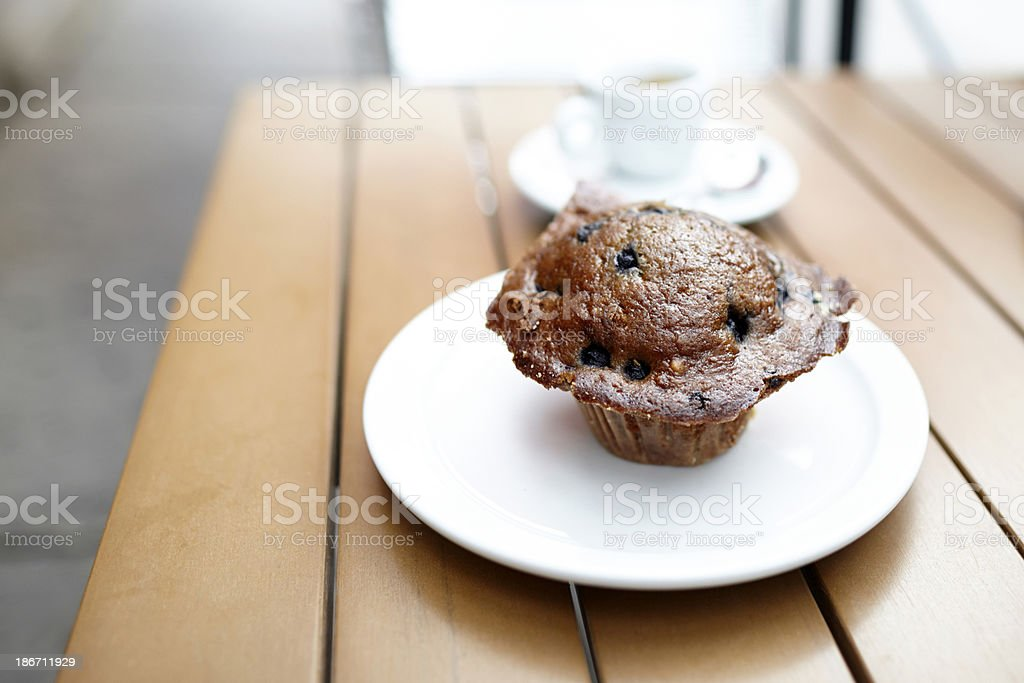 Blueberry muffin plate on table outdoors royalty-free stock photo