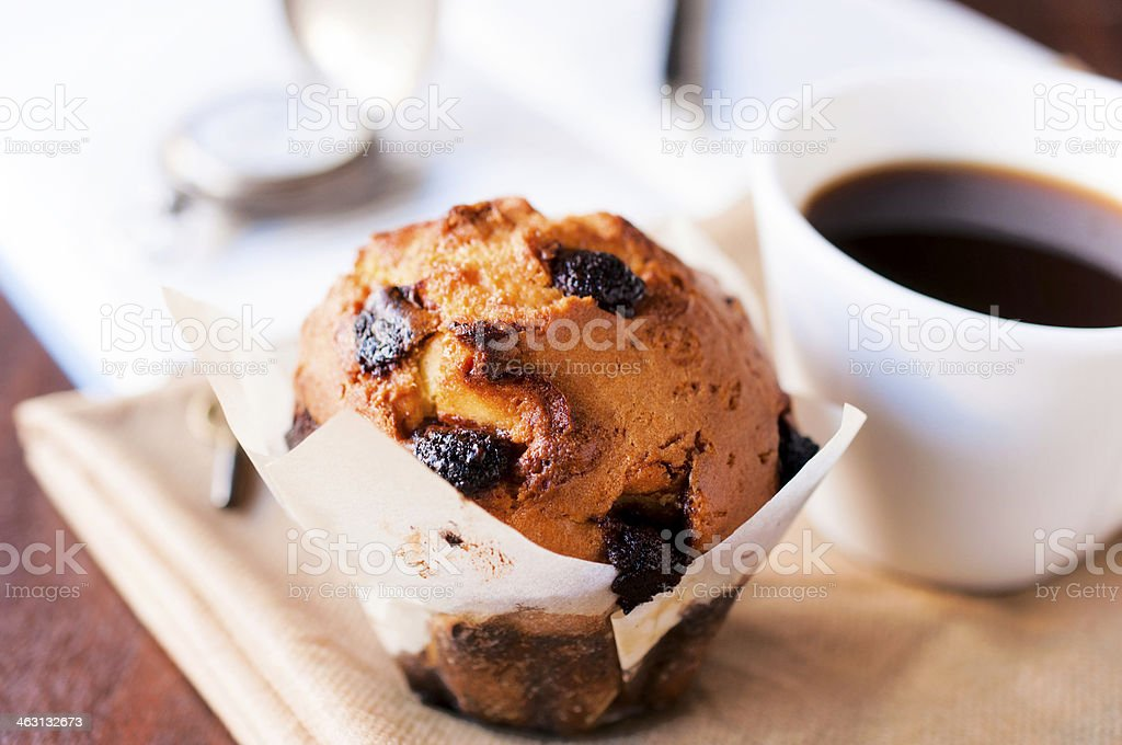Blueberry muffin with coffee in a white mug stock photo