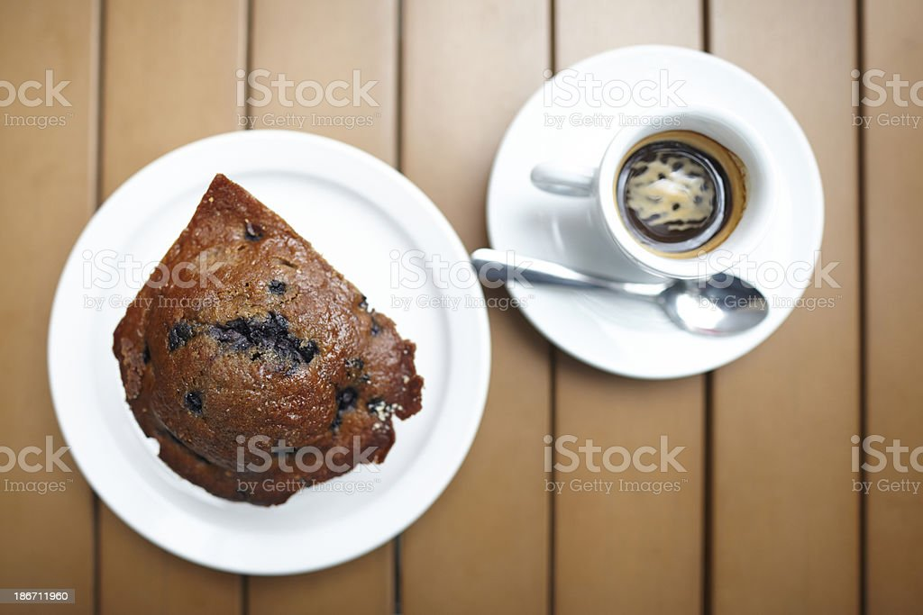 Blueberry muffin with espresso drink on table top view royalty-free stock photo