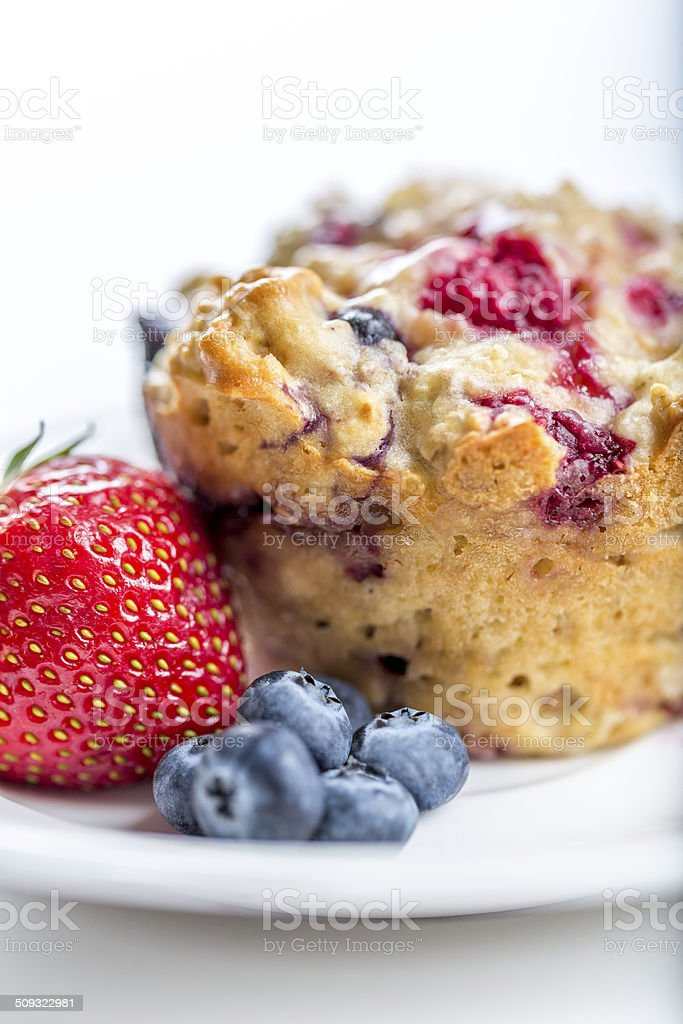 Blueberry Muffin with fresh strawberries, blueberries stock photo