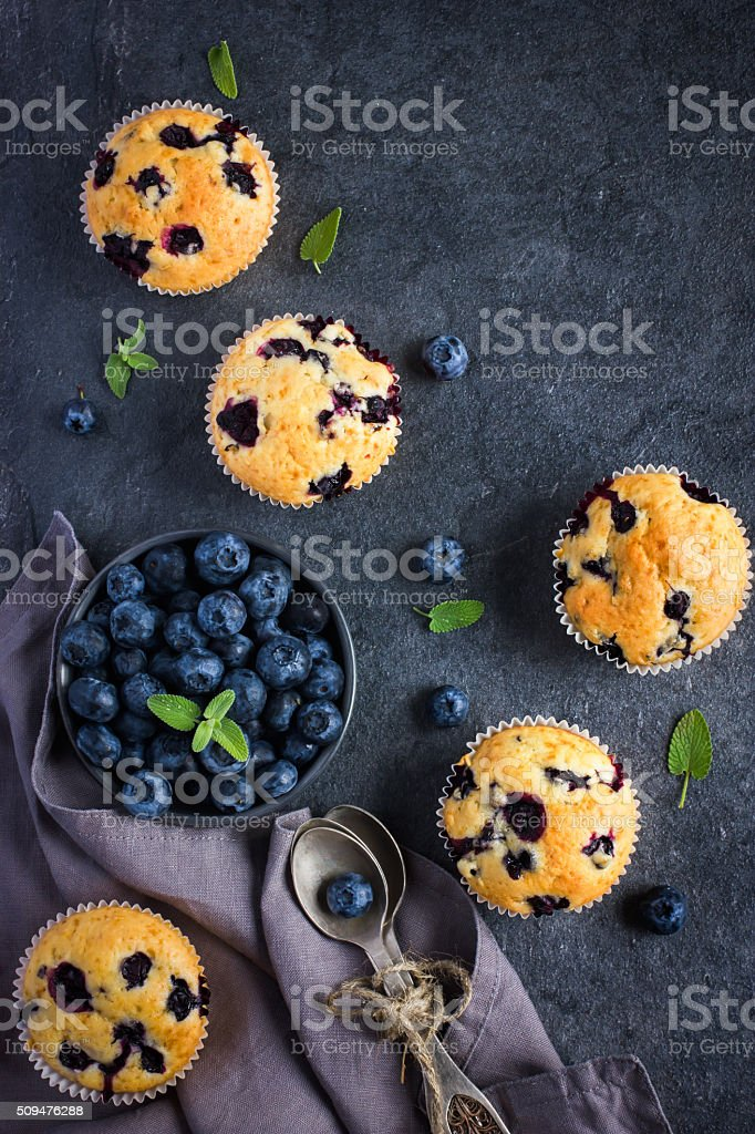 Blueberry muffins and fresh berries stock photo