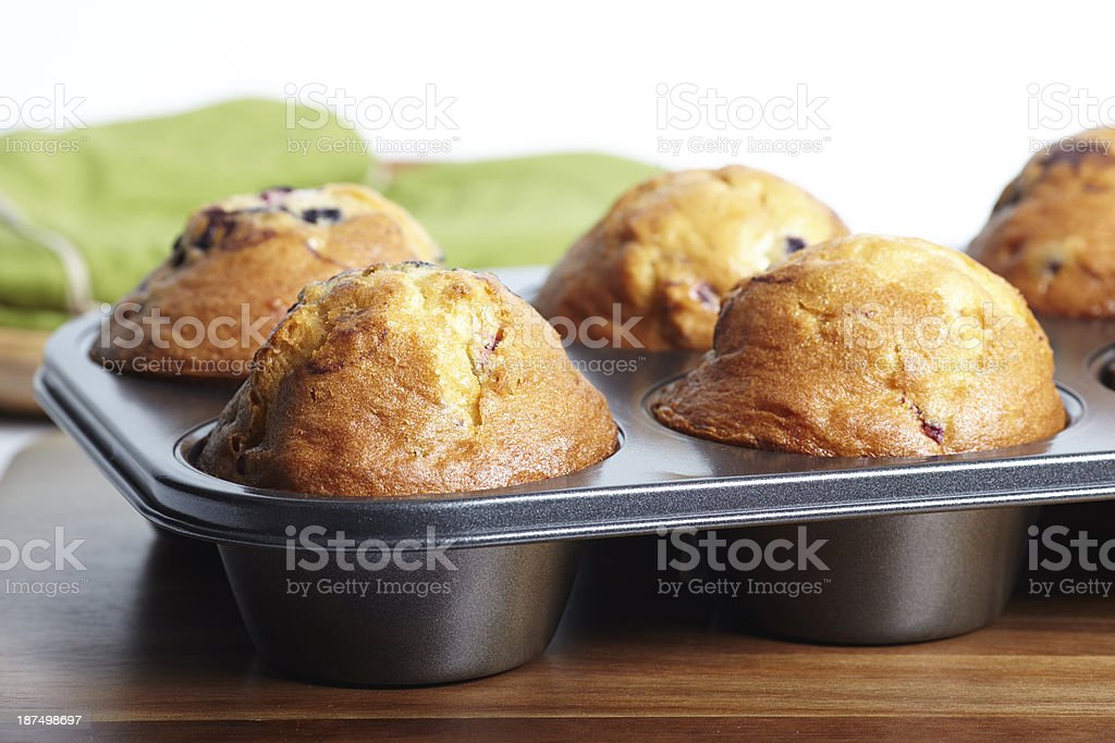 Blueberry muffins in pan close-up stock photo