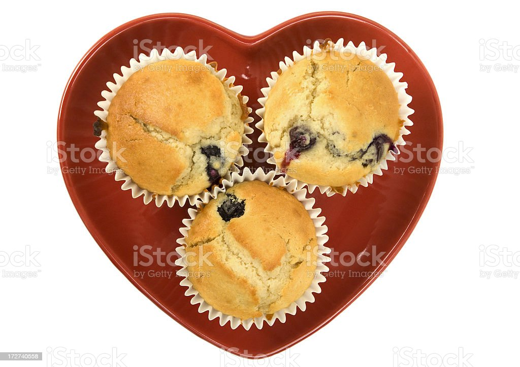 Blueberry muffins on heart plate royalty-free stock photo