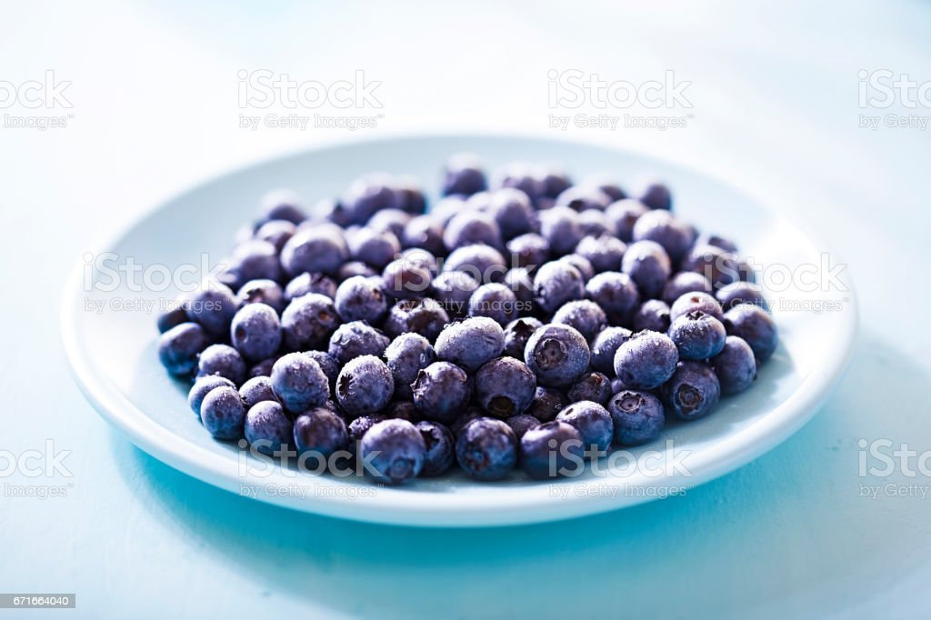 Blueberry on blue plate stock photo