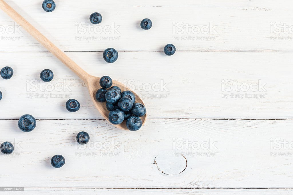 blueberry on wooden spoon, flat lay, top view stock photo