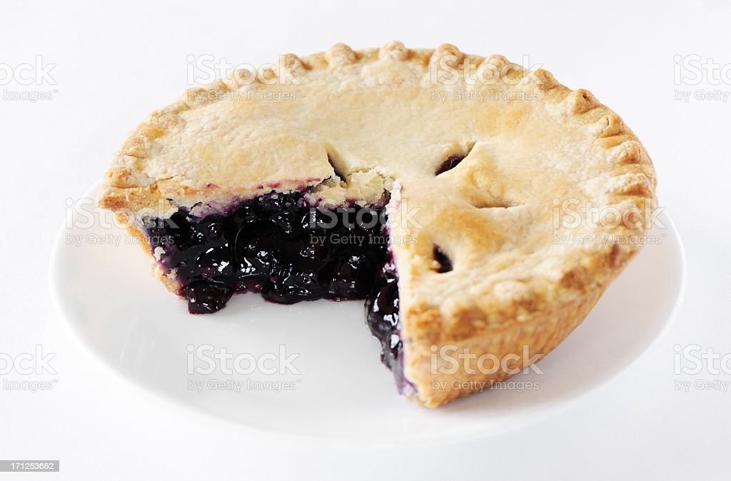 Blueberry pie with missing slice stock photo