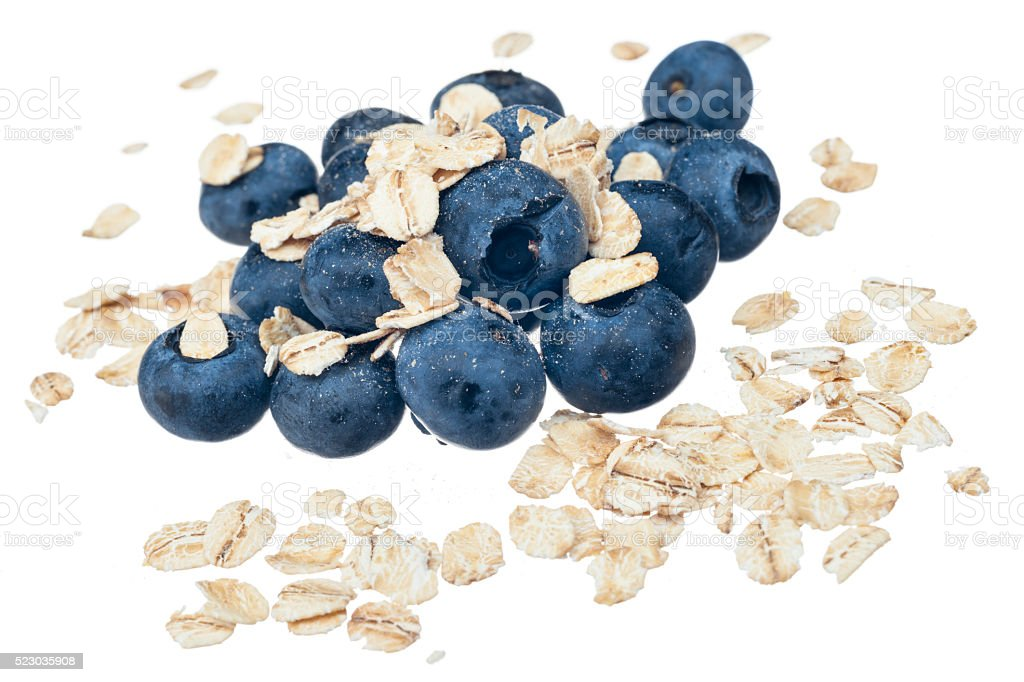 Blueberry, rolled oats, on white stock photo