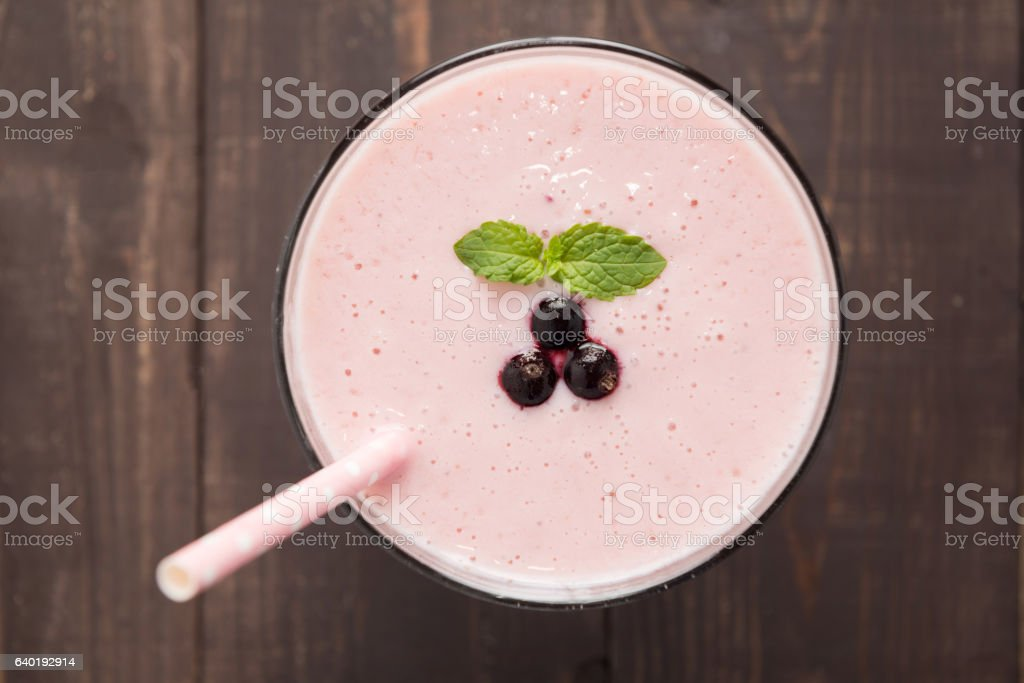 Blueberry smoothie and mint leaf on wooden background stock photo
