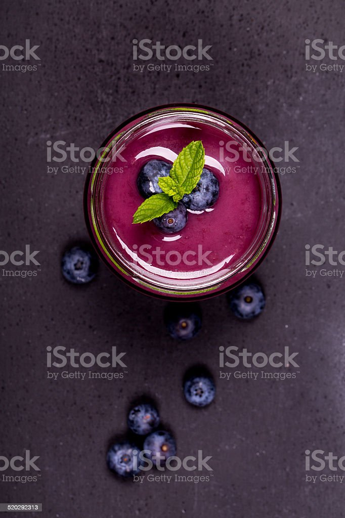 Blueberry smoothie in a glass jar stock photo