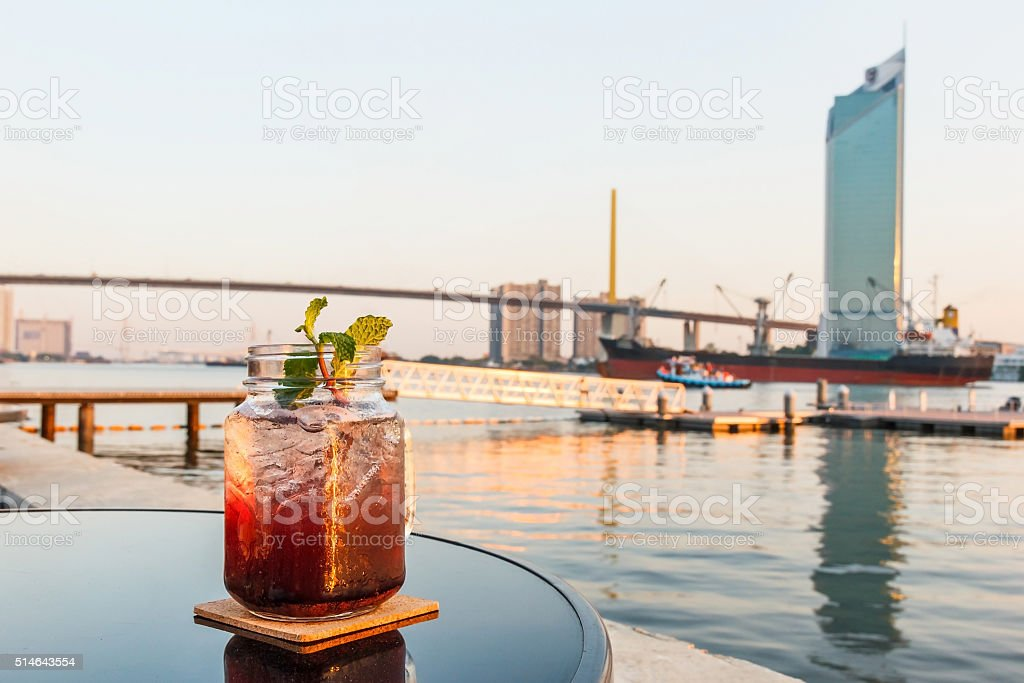Blueberry soda with blurred river. stock photo