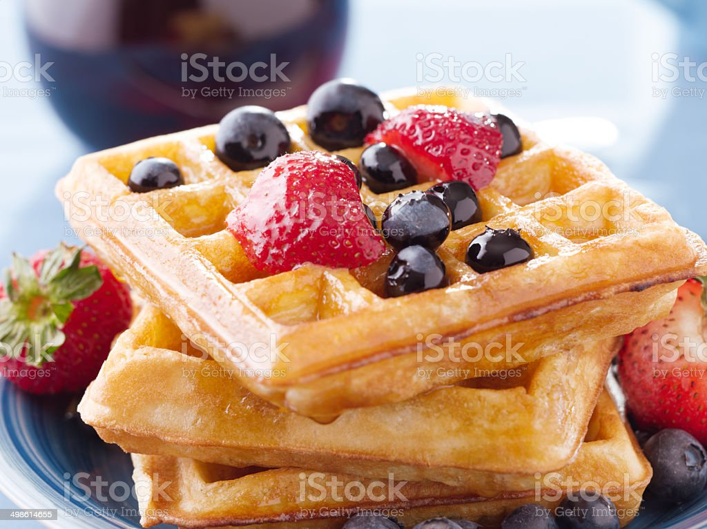blueberry waffles with strawberries stock photo