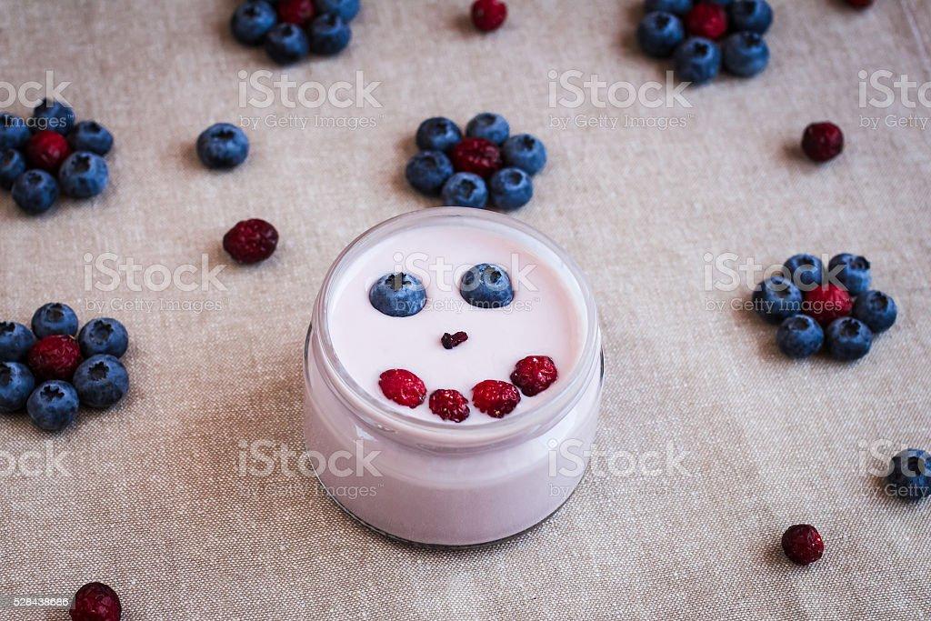 blueberry yogurt with berries on a napkin stock photo