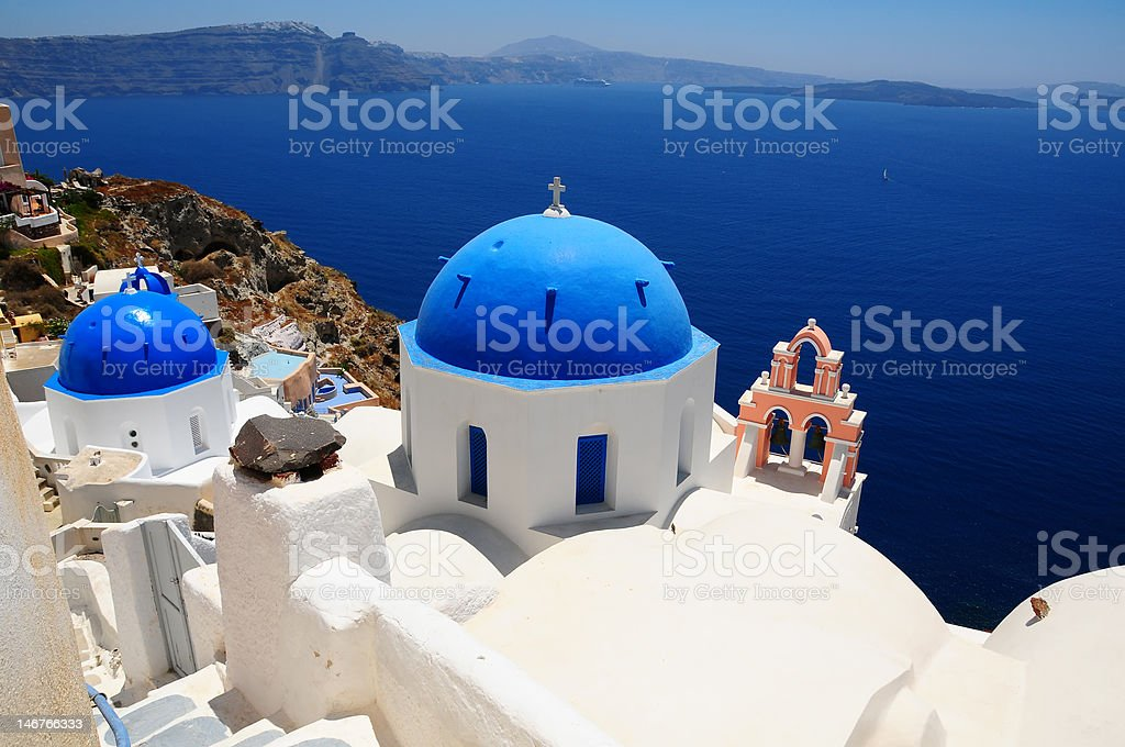 Blue-domed churches in Santorini, Greece royalty-free stock photo