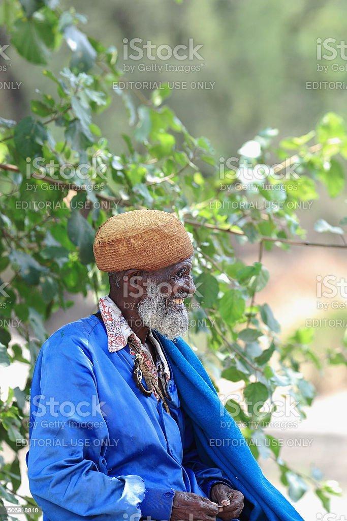 Blue-dressed local old man. Debre Birhan-Ethiopia. 0012 stock photo