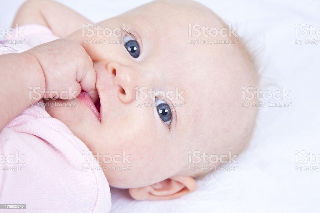 Blue-eyed baby girl stock photo