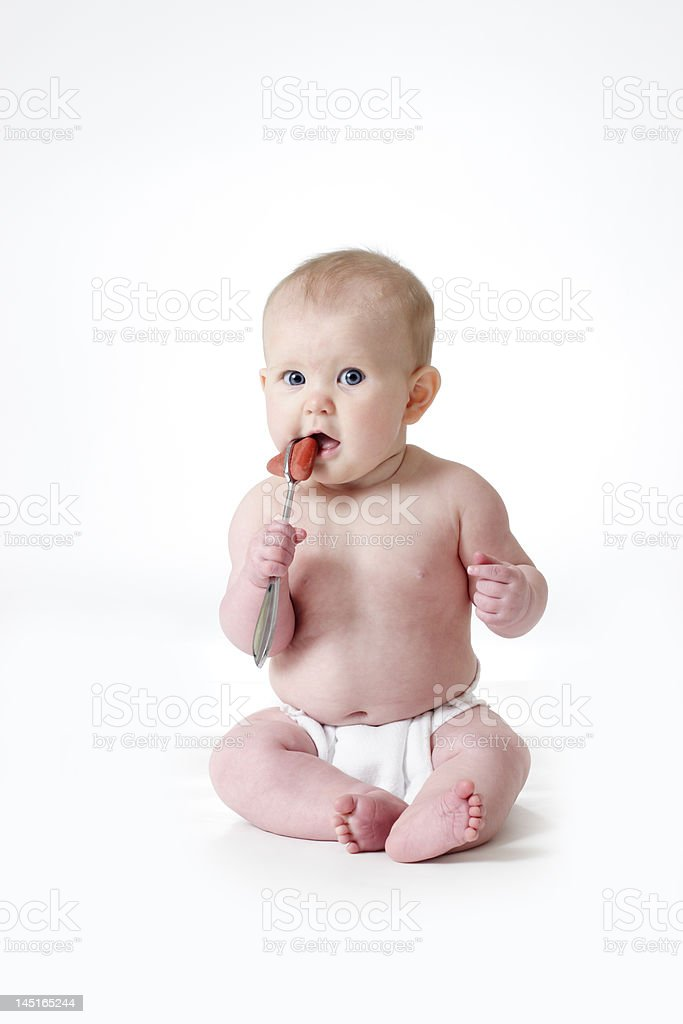 Blue-eyed Baby with Reflex Hammer royalty-free stock photo