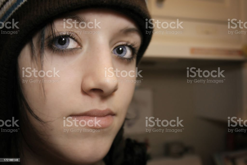 Blue-eyes teenager girl looking into distance royalty-free stock photo
