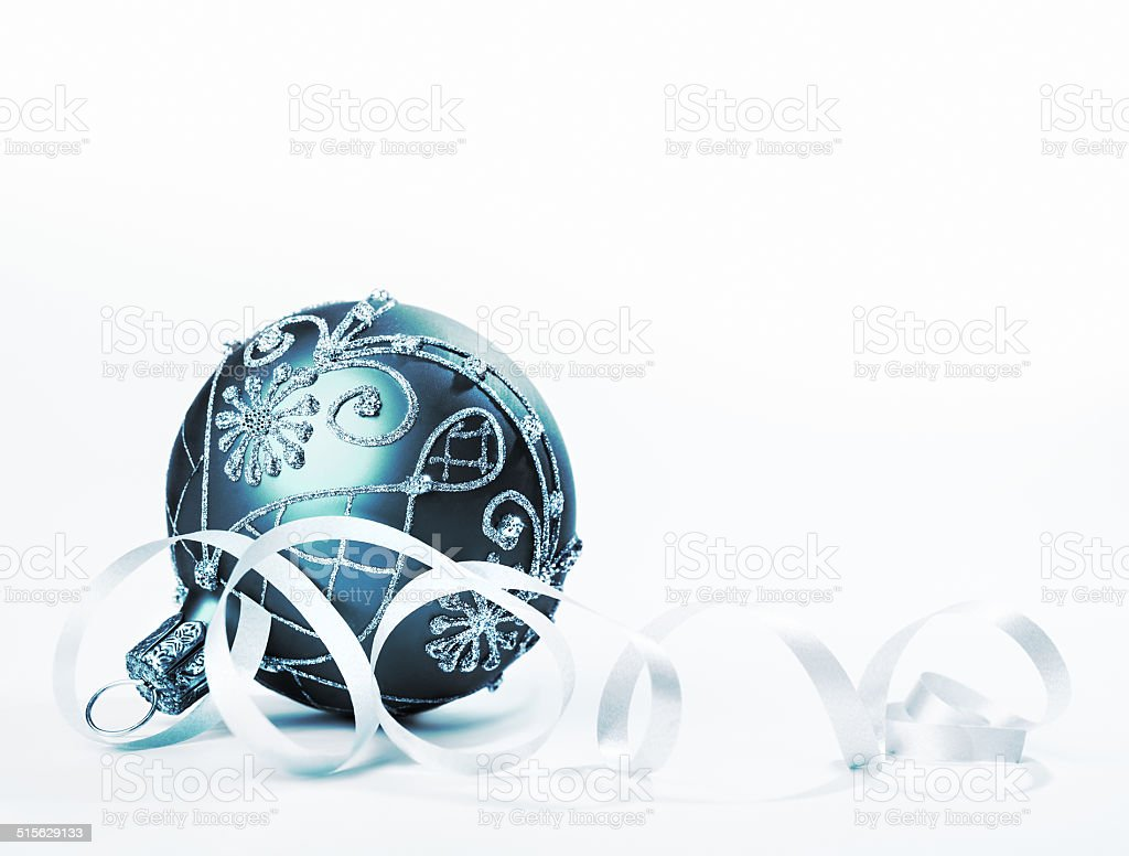 Blue-green Christmas trinket on white stock photo