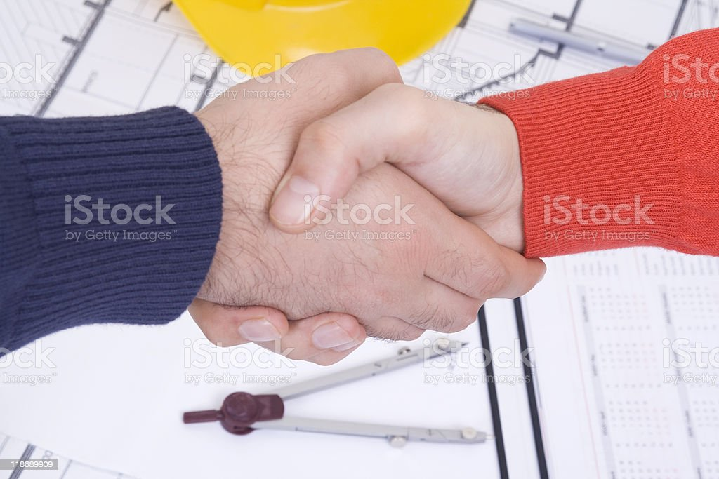 Blueprint and handshake royalty-free stock photo