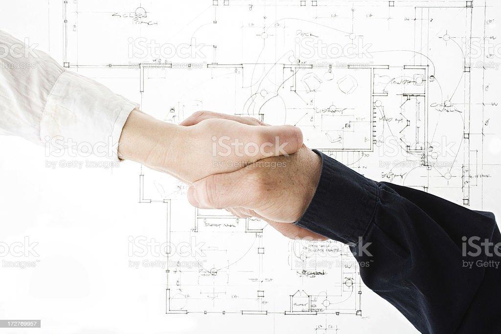 Blueprint and handshake royalty-free stock photo