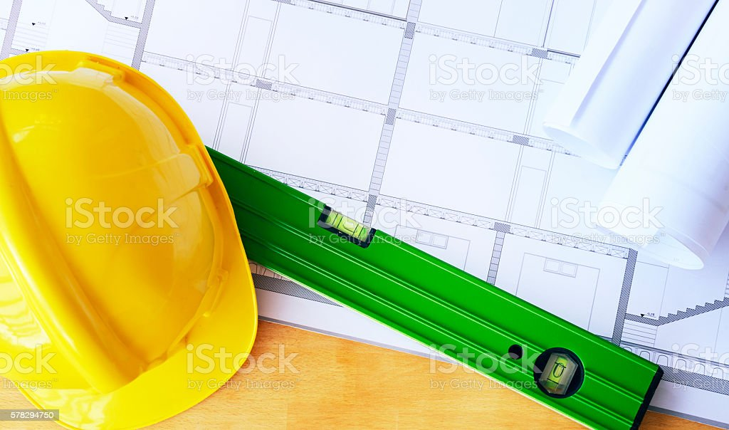 Blueprint and helmet on Desk stock photo