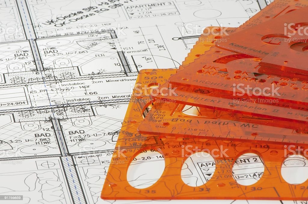 blueprint and several stencils royalty-free stock photo