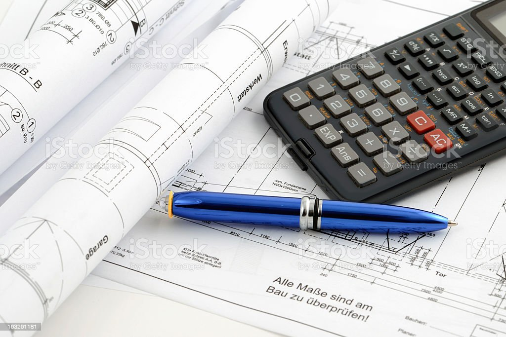 blueprint plan of house building with calculator stock photo