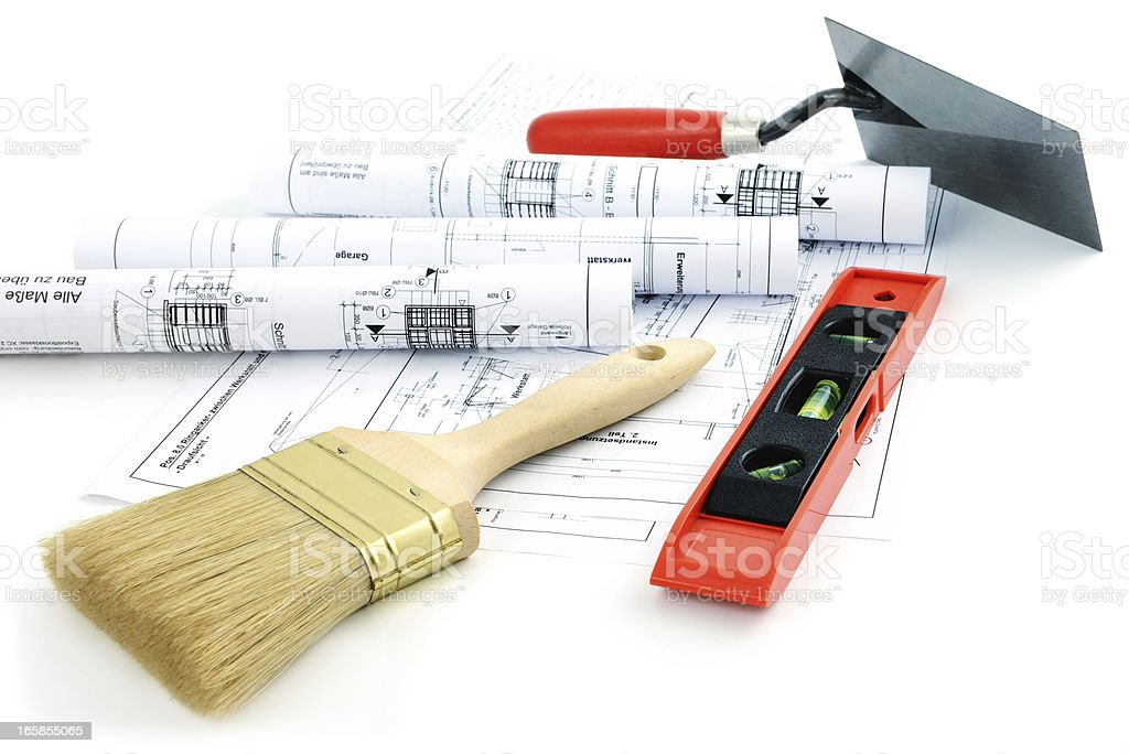blueprint plan of house building with leven trowel and brush stock photo