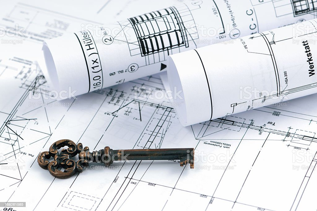 blueprint plan of house building with old door key stock photo