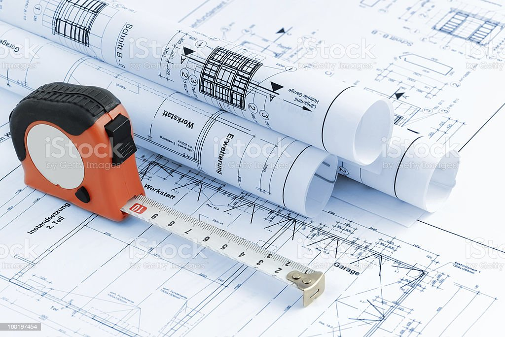 blueprint plan of house building with tape measure royalty-free stock photo