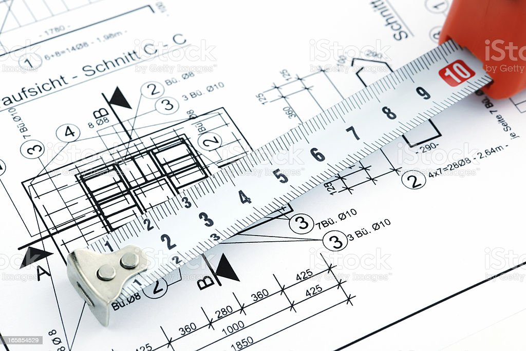 blueprint plan of house building with tape measure stock photo