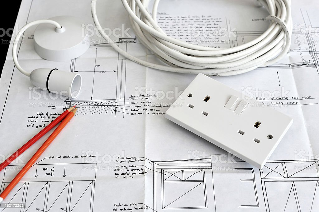 Blueprint plans of home building and construction with electrical items. stock photo