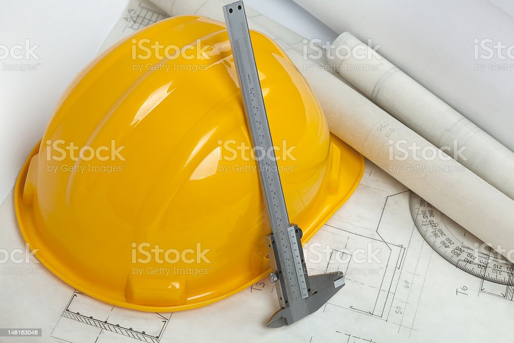 Blueprints and construction tools on table stock photo