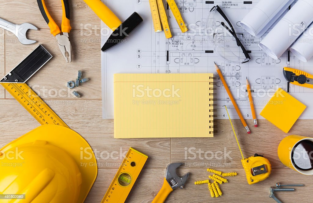 Blueprints and Construction tools stock photo