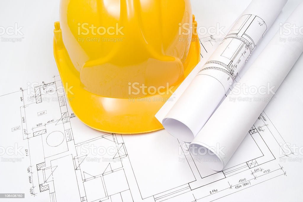 Blueprints and helmet royalty-free stock photo