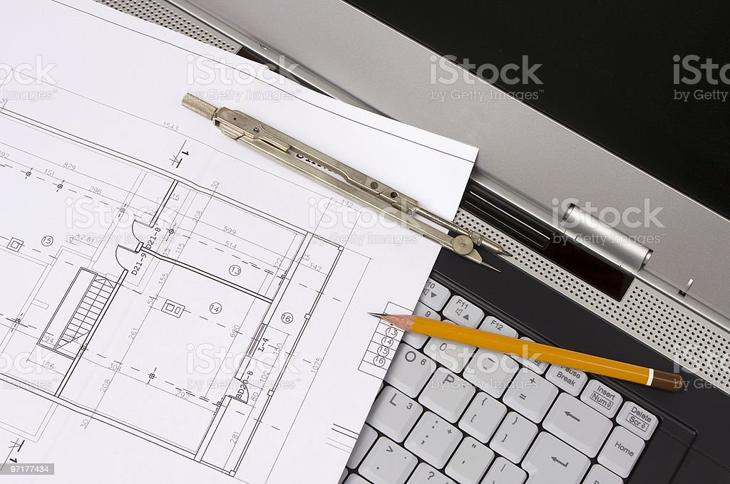 Blueprints and laptop royalty-free stock photo