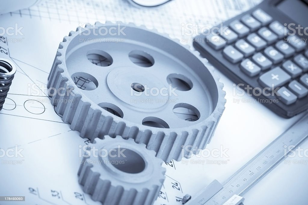 Blueprints and machine parts royalty-free stock photo