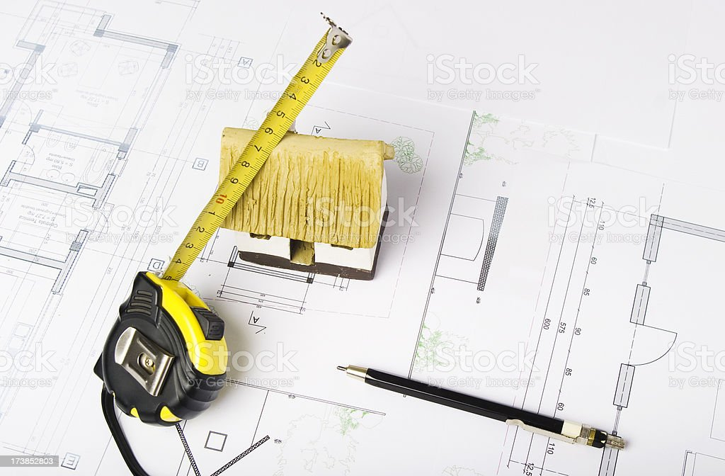 Blueprints and planing of an eco house royalty-free stock photo