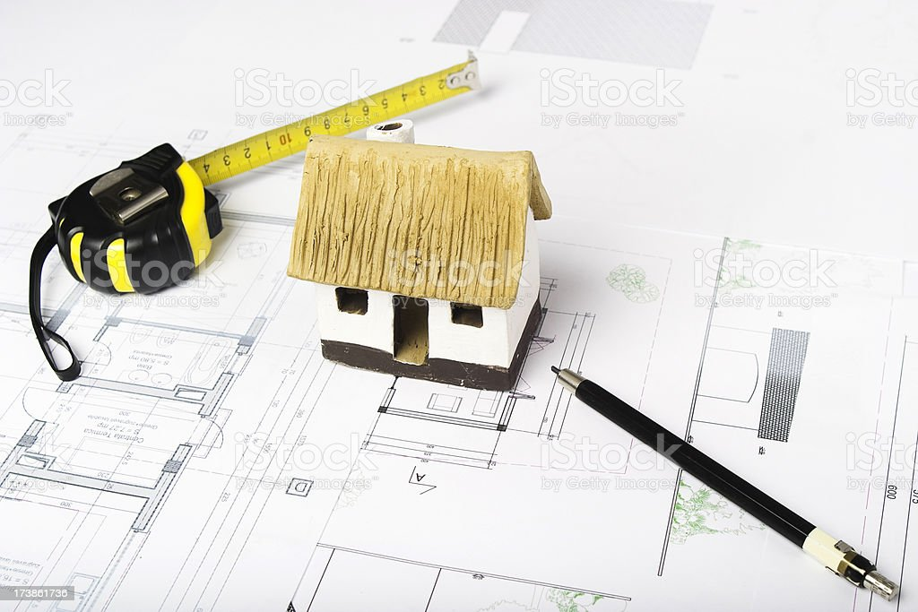 Blueprints and scale model of an eco house royalty-free stock photo